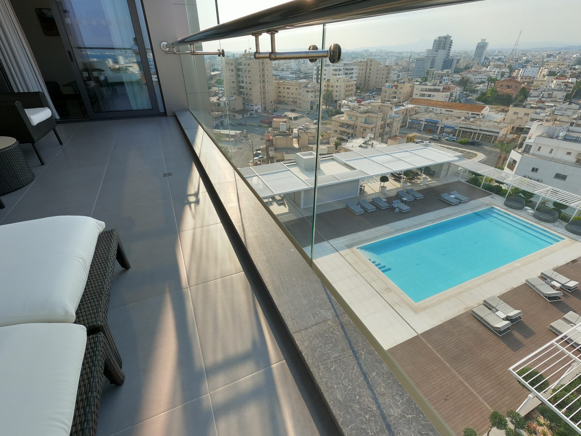 Outdoor pool and Larnaca city view